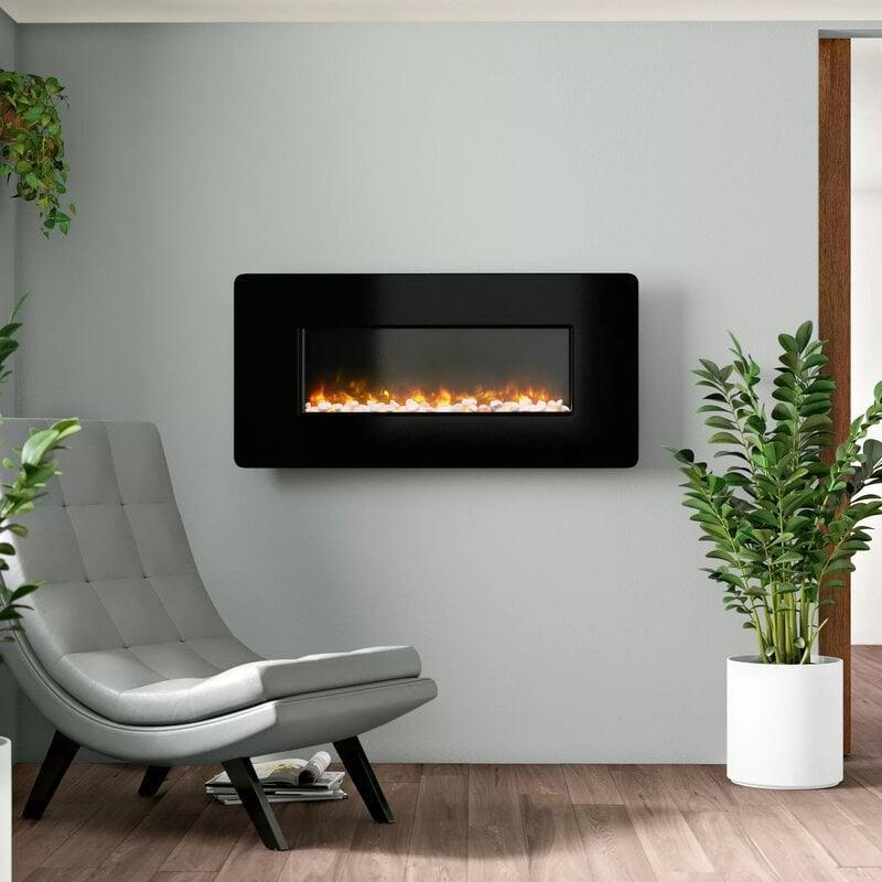 <p>If you like a more modern look, try this <span>Stockwell Curved Glass Wall Mounted Electric Fireplace</span> ($247, originally $330).</p>