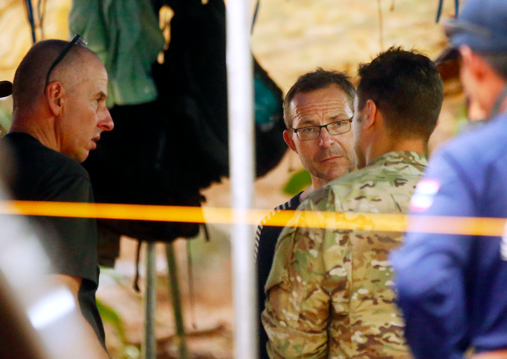 Divers Richard Stanton, left, and John Volanthen, centre, talk to US Special Operations Command Pacific Search and Rescue team personnel (Picture: PA)