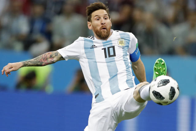 FILE - In this June 21, 2018 file photo Argentina's Lionel Messi reaches for the ball during the group D match between Argentina and Croatia at the 2018 soccer World Cup in Nizhny Novgorod Stadium in Nizhny Novgorod, Russia. Five-time winner Lionel Messi along with Cristiano Ronaldo and Virgil van Dijk are the three finalists for the FIFA best player award. (AP Photo/Ricardo Mazalan)