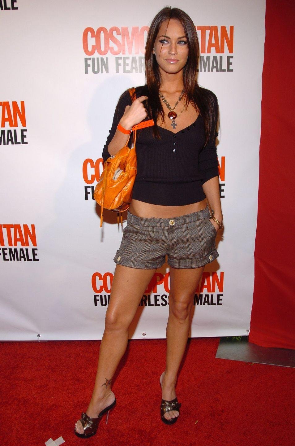 <p>Fox attended Cosmopolitan's 40th Birthday Bash in NYC wearing a pair of shorts, heels and a black knitted V-neck top, styled with a bright orange bag. </p>