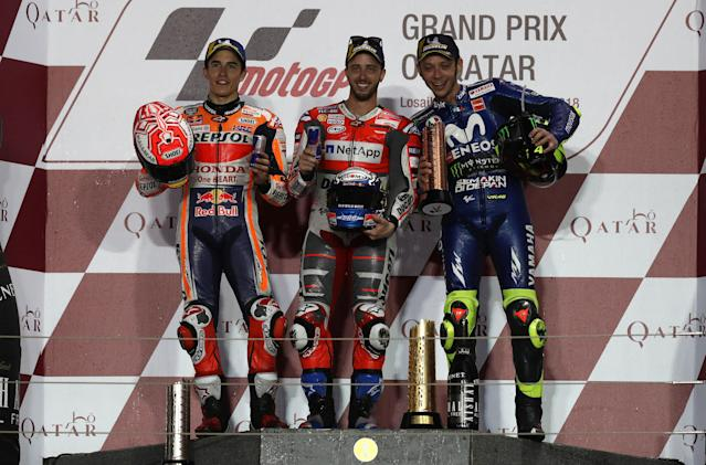 Motorcycle Racing - Qatar Motorcycle Grand Prix - MotoGP race - Losail, Qatar - March 18, 2018 - First-placed Ducati Team rider Andrea Dovizioso of Italy, second-placed Repsol Honda rider Marc Marquez of Spain, and third-placed Movistar Yamaha rider Valentino Rossi of Italy pose on the podium. REUTERS/Ibraheem Al Omari