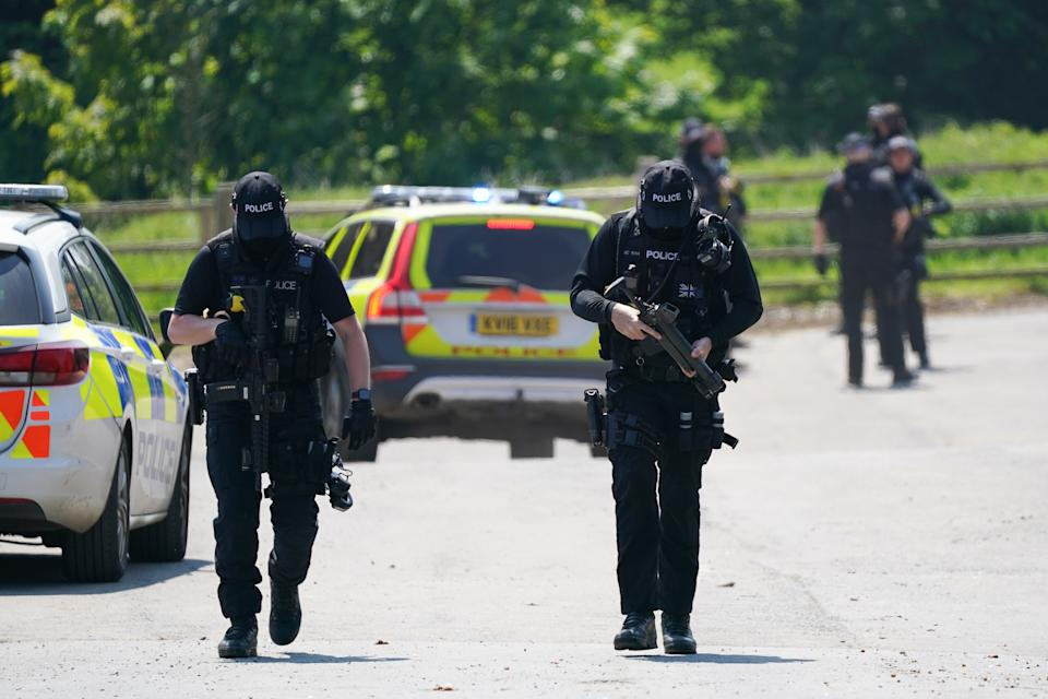Armed police at Hallington House Farm on the outskirts of Louth, Lincolnshire, after a man was detained by officers hunting for Daniel Boulton, who is sought in connection with the deaths of a 26-year-old woman and her nine-year-old son on Monday. Picture date: Tuesday June 1, 2021.