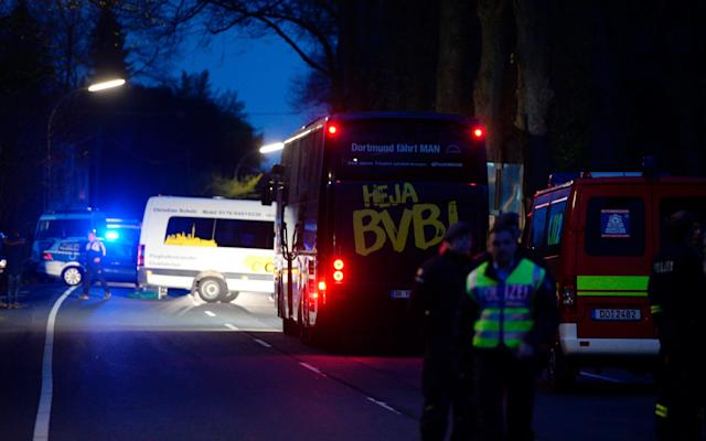 <span>Borussia Dortmund's team bus after the explosions</span> <span>Credit: AFP </span>