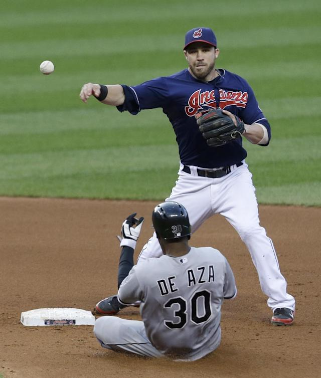 Cleveland Indians' Jason Kipnis throws to first base as Chicago White Sox's Alejandro De Aza slides into second base in the fifth inning of a baseball game, Tuesday, July 30, 2013, in Cleveland. De Aza was out at second base and Alexei Ramirez was out at first base on a double play. (AP Photo/Tony Dejak)
