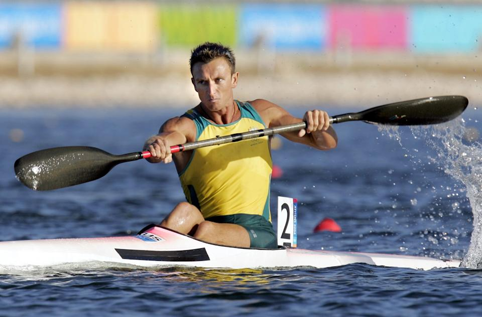 Nathan Baggaley of Australia paddles to the second place in the Men's K1 500 meter final to take the silver medal, during the kayak flatwater event at the 2004 Olympic Games in Schinias near Athens, Greece, Saturday, Aug. 28, 2004. (AP Photo/Mark J. Terrill)