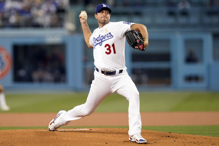 Los Angeles Dodgers starting pitcher Max Scherzer throws to an Atlanta Braves batter during the first inning of a baseball game Wednesday, Sept. 1, 2021, in Los Angeles. (AP Photo/Marcio Jose Sanchez)