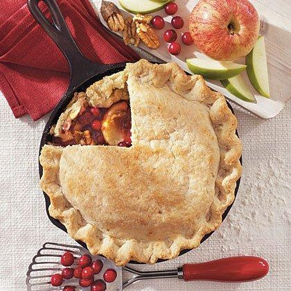 """<p>Bri Malaspino, Creative Manager at Lodge, submitted this recipe on behalf of her mother, Linda Egeto. Linda, an RN from Murfreesboro, Tennessee, created this recipe to avert a Thanksgiving-near-tragedy. </p><p><a href=""""https://www.myrecipes.com/recipe/cranberry-apple-pie-4"""" rel=""""nofollow noopener"""" target=""""_blank"""" data-ylk=""""slk:Cranberry Apple Pie Recipe"""" class=""""link rapid-noclick-resp"""">Cranberry Apple Pie Recipe</a></p>"""