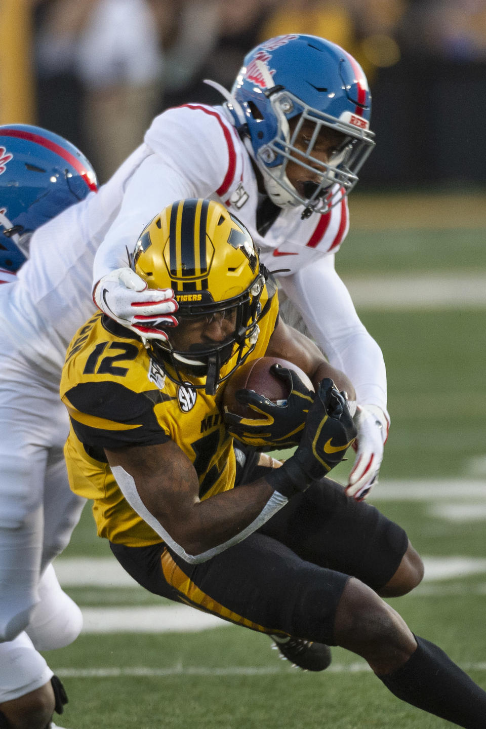 Missouri wide receiver Johnathon Johnson, bottom, is tackled by Mississippi defensive back Jon Haynes, top, during the first quarter of an NCAA college football game Saturday, Oct. 12, 2019, in Columbia, Mo. (AP Photo/L.G. Patterson)