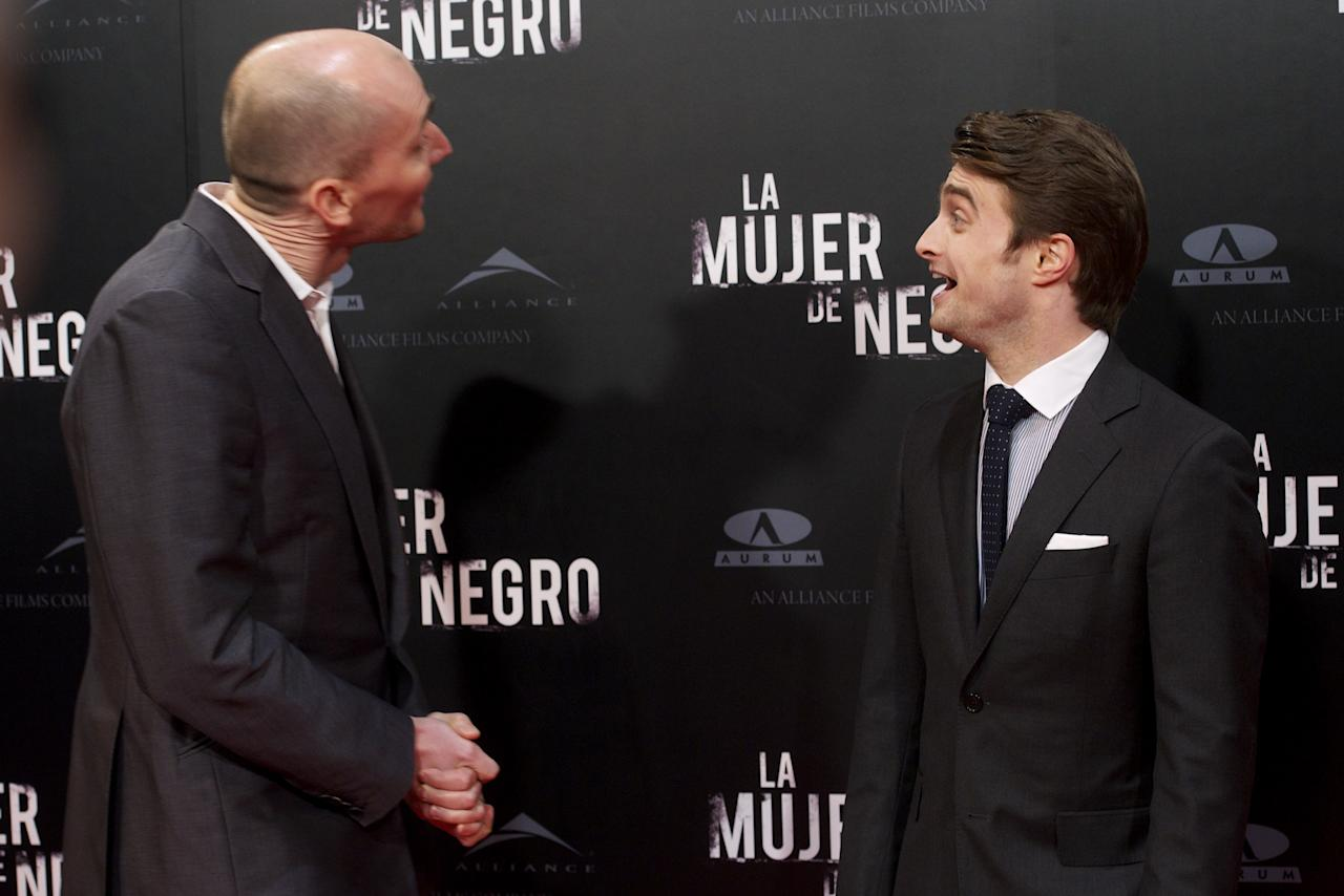 """MADRID, SPAIN - FEBRUARY 14:  Director James Watkins (L) and actor Daniel Radcliffe (R) attend """"The Woman in Black"""" (La Mujer de Negro) premiere at Callao cinema on February 14, 2012 in Madrid, Spain.  (Photo by Carlos Alvarez/Getty Images)"""