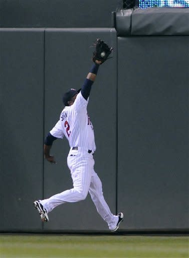 Minnesota Twins center fielder Denard Span catches a fly ball by New York Yankees' Alex Rodriguez during the sixth inning of a baseball game Tuesday, Sept. 25, 2012, in Minneapolis. (AP Photo/Jim Mone)