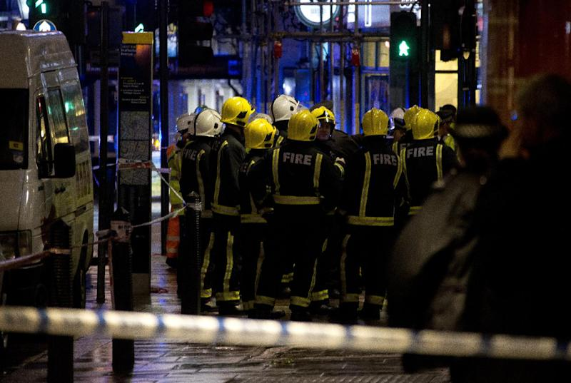 "Firemen confer at the scene following an incident at the Apollo Theatre, in London's Shaftesbury Avenue, Thursday evening, Dec. 19, 2013, during a performance at the height of the Christmas season, with police saying there were ""a number"" of casualties. It wasn't immediately clear if the roof, ceiling or balcony had collapsed during a performance. Police said they ""are aware of a number of casualties,"" but had no further details. (AP Photo by Joel Ryan, Invision)"