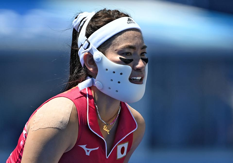 <p>Japan's Hazuki Nagai uses a protection as she plays during the women's pool B match of the Tokyo 2020 Olympic Games field hockey competition against China, at the Oi Hockey Stadium in Tokyo on July 25, 2021. (Photo by Ina Fassbender / AFP) (Photo by INA FASSBENDER/AFP via Getty Images)</p>