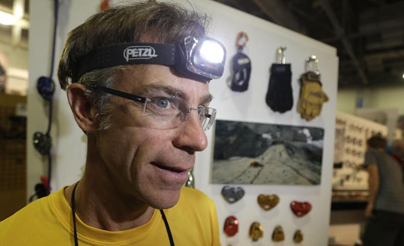 John Evans, a marketing director for Petzl, looks on during set up at the Outdoor Retailer Summer Market Tuesday, July 30, 2013, in Salt Lake City. The Outdoor Retailer Summer Market opens for a four-day run Wednesday. More than 1,300 manufacturers and suppliers are packing every square inch of the floor of a Salt Lake City convention hall. Utah has become a cottage industry for innovators and established brands including Petzl, best known for its headlamps and climbing gear.(AP Photo/Rick Bowmer)
