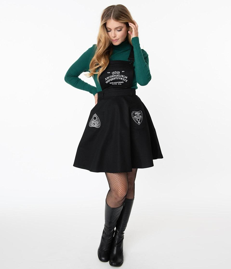 "<p>Could the <span>Hell Bunny Black Samara Pinafore Dress</span> ($82) be any more perfect for <a class=""link rapid-noclick-resp"" href=""https://www.popsugar.com/Halloween"" rel=""nofollow noopener"" target=""_blank"" data-ylk=""slk:Halloween"">Halloween</a>? </p>"