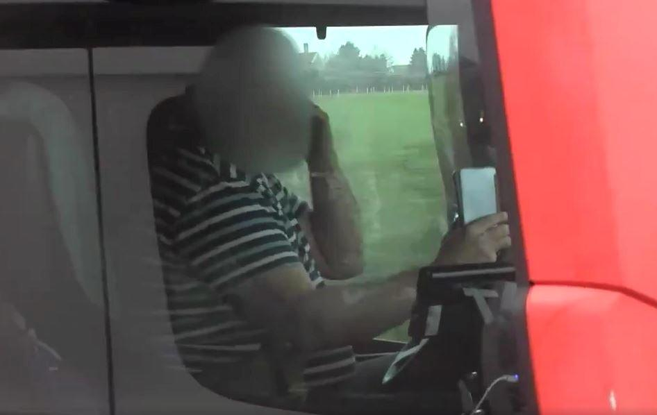 This is the moment police caught a lorry driver on the motorway holding two mobile phones - one to each ear. See SWNS story SWBRears; The footage was captured during Operation Tramline - and shows the trucker on the M4 motorway in his 44 tonne articulated lorry. Avon and Somerset Police were using a large goods vehicle (LGV) - allowing roads policing officers to gain an elevated view. The officers can be seen pulling alongside the lorry driver, who quickly removes the phones from his ears to put both hands back on the steering wheel. The offending vehicle was then reported to a supporting policing unit which intercepted, indicated for it to pull over and dealt with offences. Chief Inspector Jason Shears, Roads Policing Lead for Avon and Somerset Police, said: