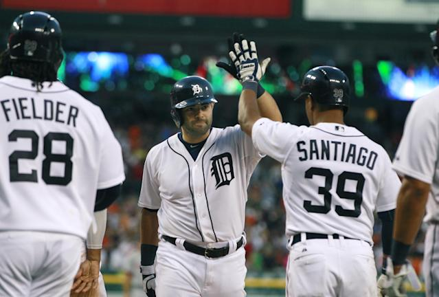 Detroit Tigers' Alex Avila, center, is congratulated by teammates Prince Fielder and Ramon Santiago after his grand slam off Washington Nationals starting pitcher Stephen Strasburg during the sixth inning of a baseball game in Detroit, Tuesday, July 30, 2013. (AP Photo/Carlos Osorio)