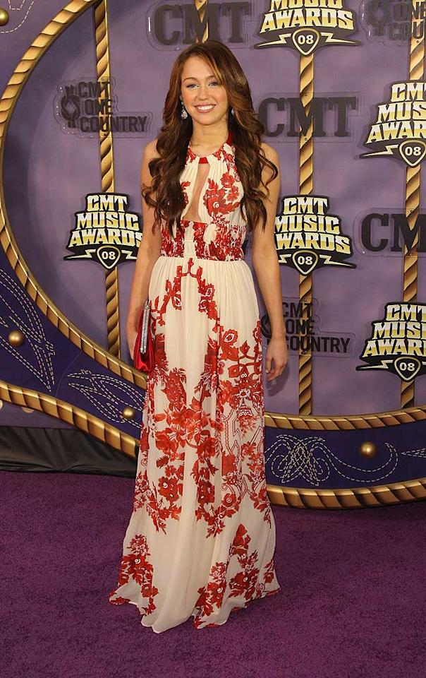 """CMT Music Awards host Miley Cyrus delighted in a flowy red and white halter dress. Stephen Lovekin/<a href=""""http://www.gettyimages.com/"""" target=""""new"""">GettyImages.com</a> - April 14, 2008"""