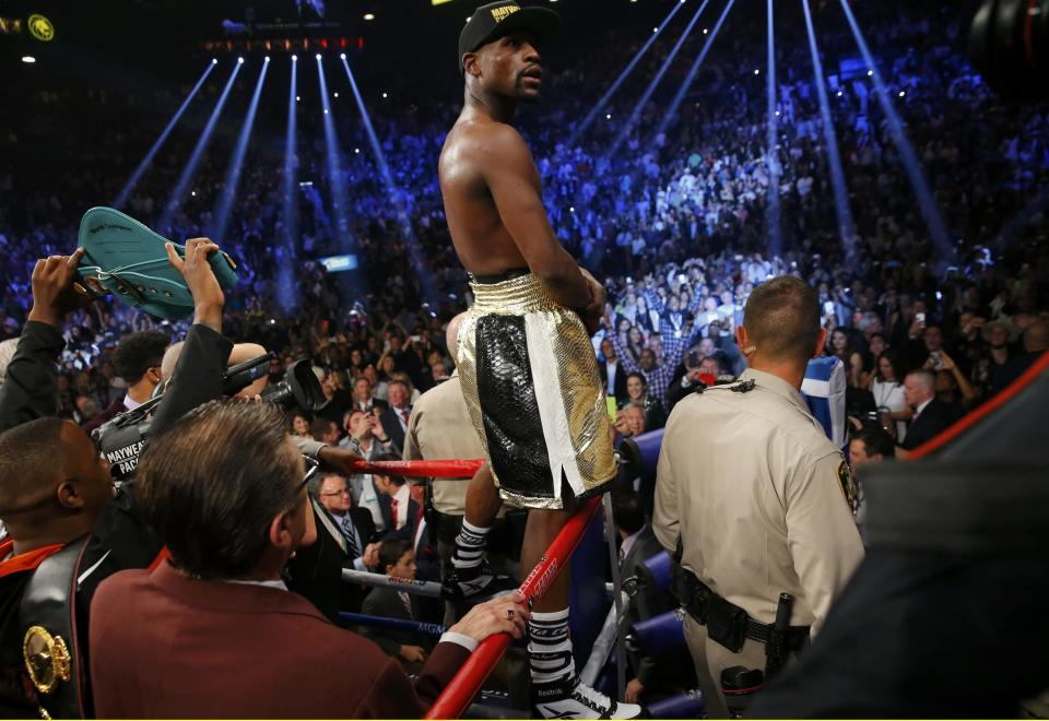 Floyd Mayweather, Jr. of the U.S. stands up on the ropes in his corner after defeating Manny Pacquiao of the Philippines in their welterweight WBO, WBC and WBA (Super) title fight in Las Vegas, Nevada, May 2, 2015. REUTERS/Steve Marcus