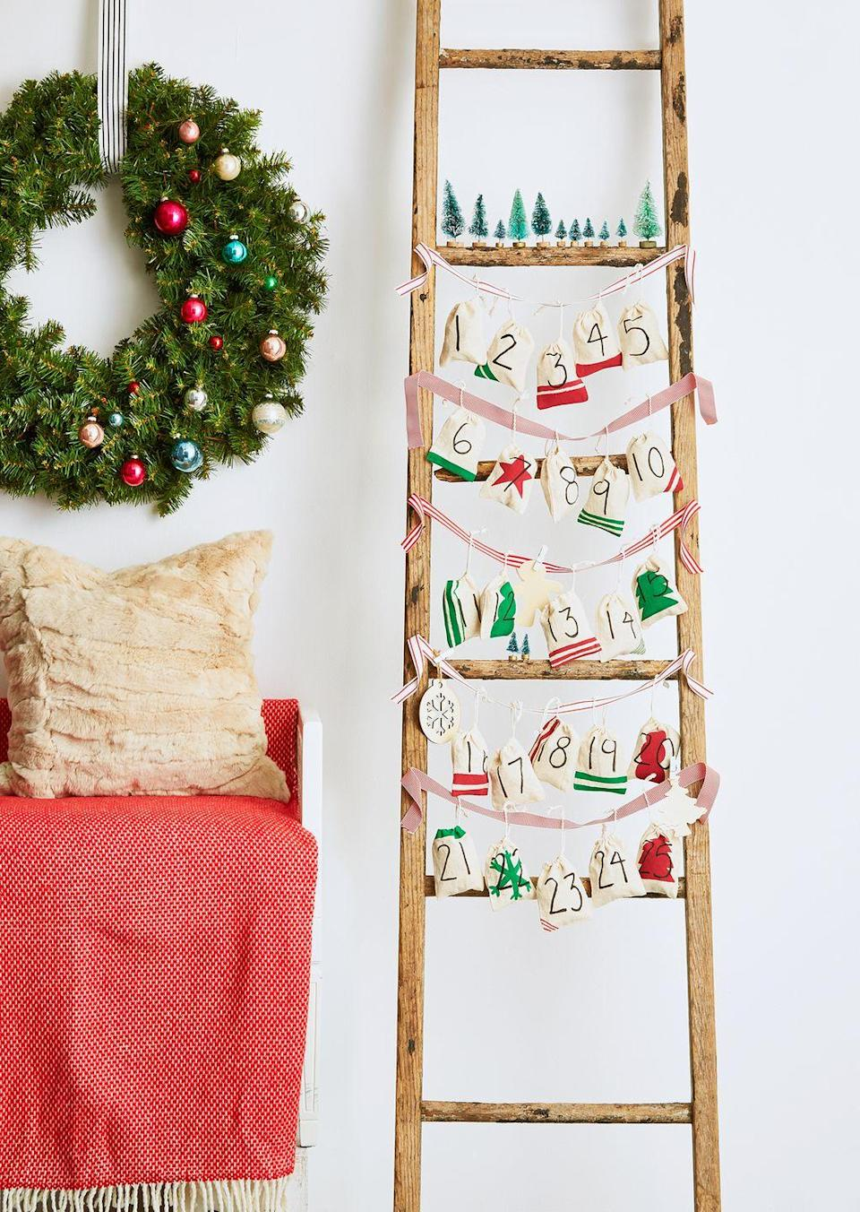<p>Decorative ladders are versatile, especially for the holiday season. Let yours function as an advent calendar this year. Tie ribbon across each rung of the ladder, and then use them to hang numbered burlap bags. </p>