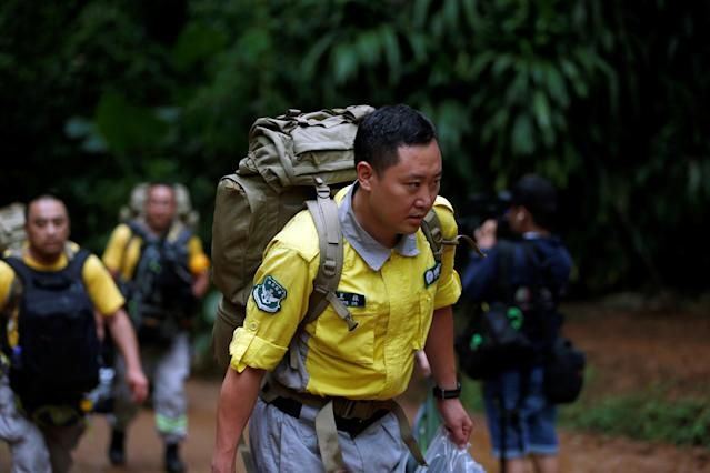 <p>A Chinese rescue team arrives near the Tham Luang cave complex as a search for members of an under-16 soccer team and their coach continues, in the northern province of Chiang Rai, Thailand, June 30, 2018. (Photo: Soe Zeya Tun/Reuters) </p>