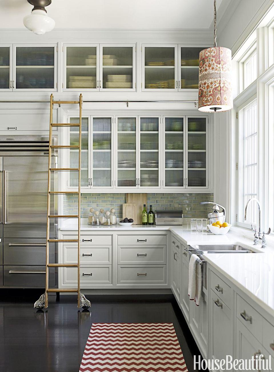 "<p>The <span class=""redactor-unlink"">subtle color in this kitchen</span> bring a coziness to the space, but don't distract from its traditional style. And we need to talk about that insanely cool rolling ladder. Plus, it'll keep things organized. </p>"