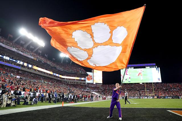"""TAMPA, FL – JANUARY 09: A <a class=""""link rapid-noclick-resp"""" href=""""/ncaab/teams/cbg/"""" data-ylk=""""slk:Clemson Tigers"""">Clemson Tigers</a> cheerleader waves a flag in the end zone during in the 2017 College Football Playoff National Championship Game between the <a class=""""link rapid-noclick-resp"""" href=""""/ncaab/teams/aaf/"""" data-ylk=""""slk:Alabama Crimson Tide"""">Alabama Crimson Tide</a> and the Clemson Tigers at Raymond James Stadium on January 9, 2017 in Tampa, Florida. (Photo by Tom Pennington/Getty Images)"""