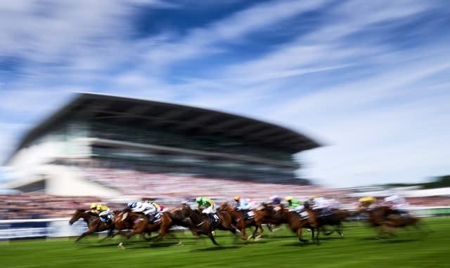 Ornate, ridden by jockey Phil Dennis, on the way to winning the Investec Dash Handicap during Derby Day at Epsom. The David Griffiths-trained six-year-old, left, made virtually every yard of the running to claim a surprise victory by a neck (John Walton/PA)