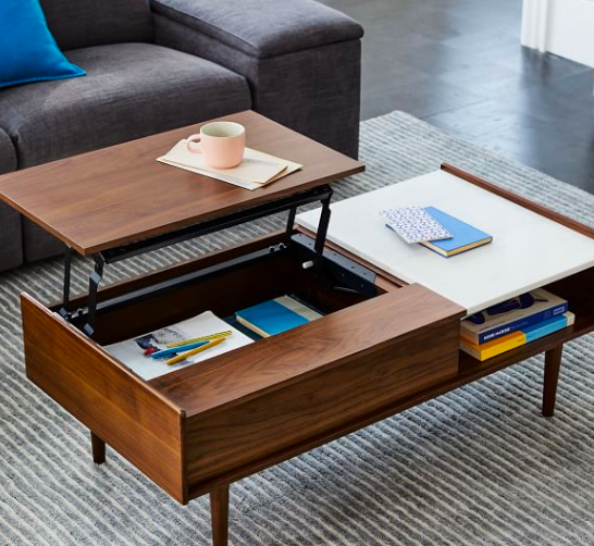 """<h2>West Elm Mid-Century Pop-Up Storage Coffee Table</h2><br>This coffee-table-turned-desk transformer is a godsend for when working cross-legged on your living room floor gets...tired. Plus, the elevated platform doubles as a supplementary dining surface, too. <br><br><strong>West Elm</strong> Mid-Century Pop-Up Storage Coffee Table, $, available at <a href=""""https://go.skimresources.com/?id=30283X879131&url=https%3A%2F%2Fwww.westelm.com%2Fproducts%2Fmid-century-pop-up-storage-coffee-table-h1903%2F%3Fpkey%3Dcsmall-space-solutions%26isx%3D0.0"""" rel=""""nofollow noopener"""" target=""""_blank"""" data-ylk=""""slk:West Elm"""" class=""""link rapid-noclick-resp"""">West Elm</a>"""