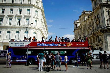 Tourists disembark from a Chinese-made double-decker Yutong bus in Havana, Cuba