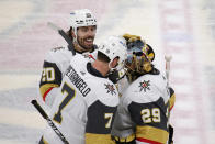 Vegas Golden Knights defenseman Alex Pietrangelo (7) congratulates goaltender Marc-Andre Fleury (29) as center Chandler Stephenson (20) smiles after the team's NHL hockey game against the Minnesota Wild, Wednesday, May 5, 2021, in St. Paul, Minn. The Golden Knights won 3-2 in overtime on Pietrangelo's goal. (AP Photo/Andy Clayton-King)