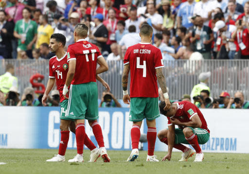 Morocco players react in dejection at the end of the group B match between Portugal and Morocco at the 2018 soccer World Cup at the Luzhniki Stadium in Moscow, Russia, Wednesday, June 20, 2018. (AP Photo/Antonio Calanni)