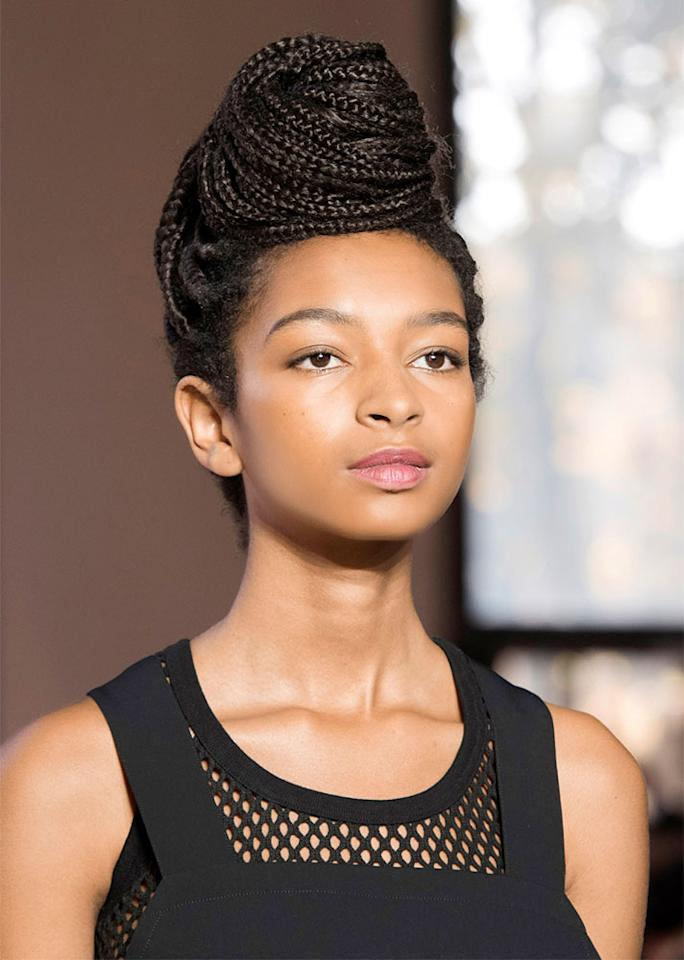 For a protective style, such as braids or twists, swirl your strands into a towering beehive style.
