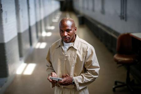 Inmate Marvin Worthy poses while using his JPay tablet device inside the East Jersey State Prison in Rahway, New Jersey, U.S., July 12, 2018.  REUTERS/Brendan McDermid