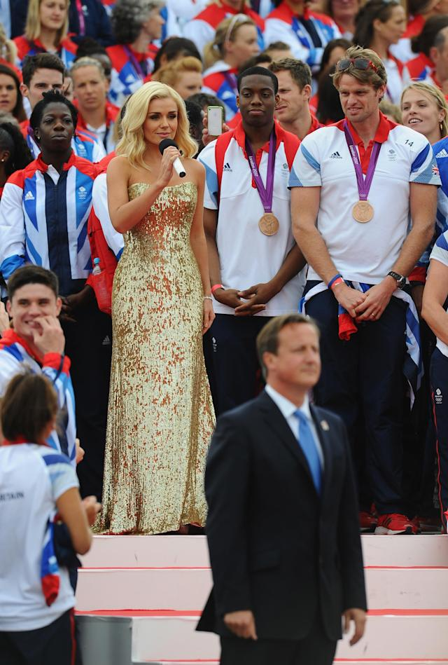 LONDON, ENGLAND - SEPTEMBER 10: Katherine Jenkins sings the National Anthem during the Olympics & Paralympics Team GB London 2012 Victory Parade on September 10, 2012 in London, England. (Photo by Mike Hewitt/Getty Images)
