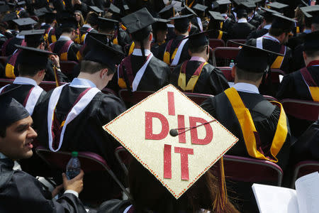 "Graduating student has ""I Did It"" written on her mortar board during Commencement Exercises at Boston College"