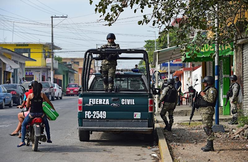 Mexican police patrol in Veracruz State, where scores of Central Americans being smuggled to the United States have been rescued from an abandoned truck