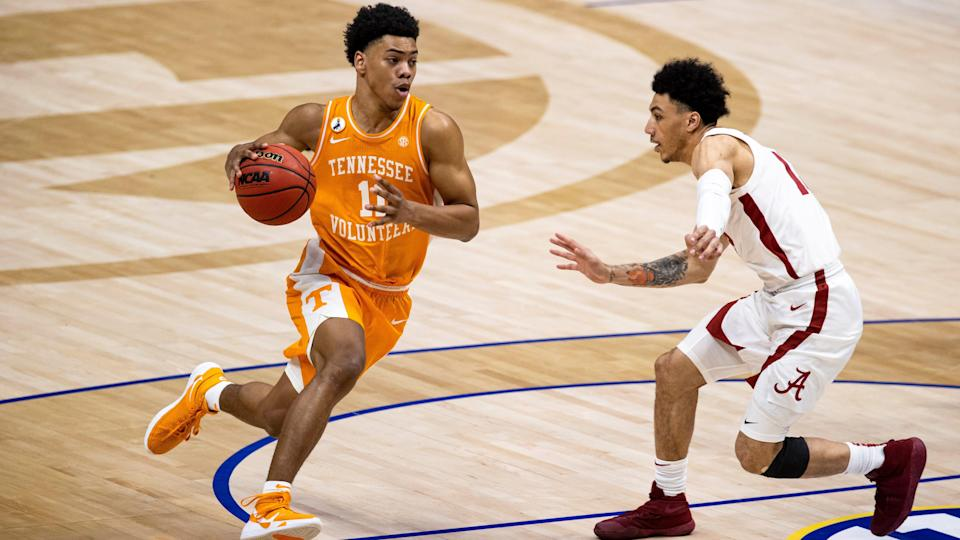 NASHVILLE, TN - MARCH 13:  Jaden Springer #11 of the Tennessee Volunteers drives to the basket against the Alabama Crimson Tide during the first half of their semifinal game in the SEC Men's Basketball Tournament at Bridgestone Arena on March 13, 2021 in Nashville, Tennessee. (Photo by Brett Carlsen/Getty Images) ORG XMIT: 775629790 ORIG FILE ID: 1231692453