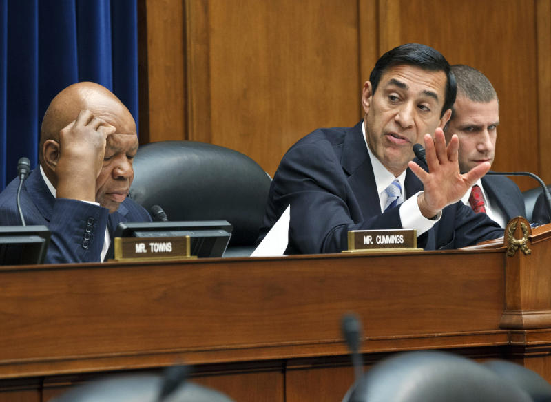 Rep. Darrell Issa, R-Calif., right, chairman of the House Oversight and Government Reform Committee, manages a series of amendments as they consider a vote to hold Attorney General Eric Holder in contempt of Congress, on Capitol Hill in Washington, Wednesday, June 20, 2012. Rep. Elijah Cummings, D-Md., the ranking member, watches from left. In a showdown with President Barack Obama's administration, House Republicans had pressed for more Justice Department documents on the flawed gun-smuggling probe known as Operation Fast and Furious that resulted in hundreds of guns illicitly purchased in Arizona gun shops winding up in the hands of Mexican drug cartels. (AP Photo/J. Scott Applewhite)