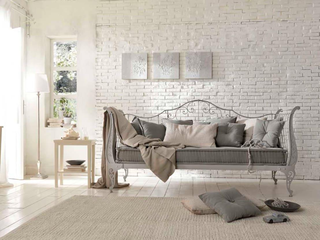 <p>Bare brick or painted bricks are a fabulous feature wall idea and bring a really rustic and imperfect look into play. Smooth plaster is more synonymous with a contemporary design scheme, but bricks add a softer touch.</p>  Credits: homify / Leon s.r.l.