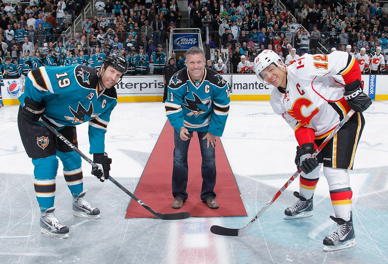 Owen Nolan takes part in a ceremonial faceoff in San Jose on Wednesday.