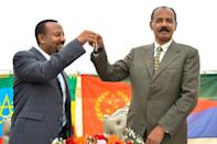 Rapprochement: Abiy, left, and Afwerki celebrate the reopening of Eritrean embassy in Addis Ababa in July 2018