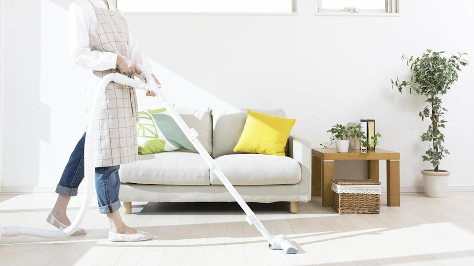 vacuuming the living room