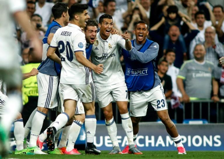 Real Madrid's forward Cristiano Ronaldo (2R) celebrates a goal during the UEFA Champions League quarter-final second leg football match Real Madrid vs FC Bayern Munich at the Santiago Bernabeu stadium in Madrid in Madrid on April 18, 2017