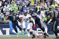Seattle Seahawks quarterback Russell Wilson (3) tries to pass against the Tennessee Titans in overtime of an NFL football game, Sunday, Sept. 19, 2021, in Seattle. The Titans won 33-30. (AP Photo/Elaine Thompson)