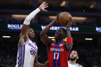 Detroit Pistons forward Tony Snell, right, goes to the basket against Sacramento Kings guard Buddy Hield, left, during the first half of an NBA basketball game in Sacramento, Calif., Sunday, March 1, 2020. (AP Photo/Rich Pedroncelli)