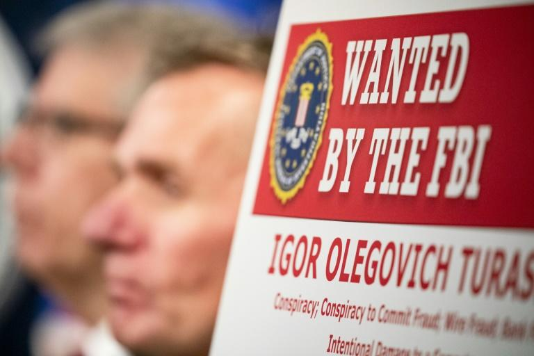 Two Russian nationals indicted on charges of hacking in December are believed to be behind a new ransomware scheme targeting US firms, according to security experts (AFP Photo/Samuel Corum)