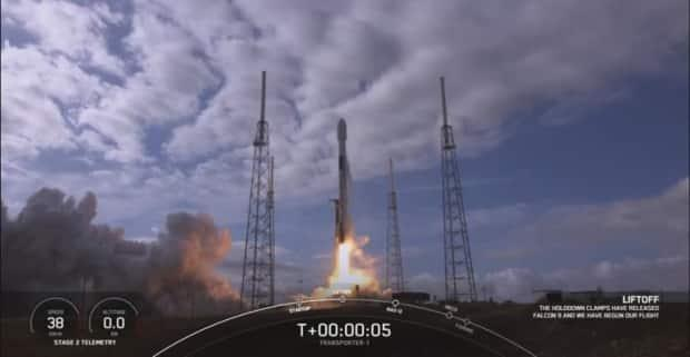 The SpaceX Falcon 9 rocket successfully completes a mission to deploy 143 spacecraft and satellites into orbit on Sunday before returning safely to a sea-based landing pad.
