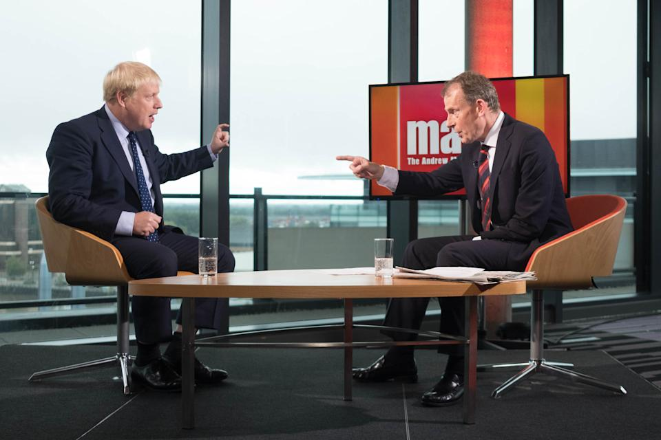 Prime Minister Boris Johnson (left) speaking on the BBC's Andrew Marr show at Media City in Salford before opening the Conservative party annual conference at the Manchester Convention Centre.
