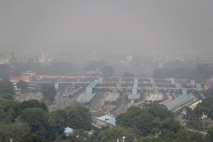 """A thin layer of smog envelops a train station in New Delhi, India, Wednesday, Oct. 16, 2019. The Indian capital's air quality levels have plunged to """"poor,"""" a day after the government initiated stricter measures to fight chronic air pollution. The state-run Central Pollution Control Board's air quality index for New Delhi stood at 299 on Wednesday, about six times the recommended level. (AP Photo/Altaf Qadri)"""
