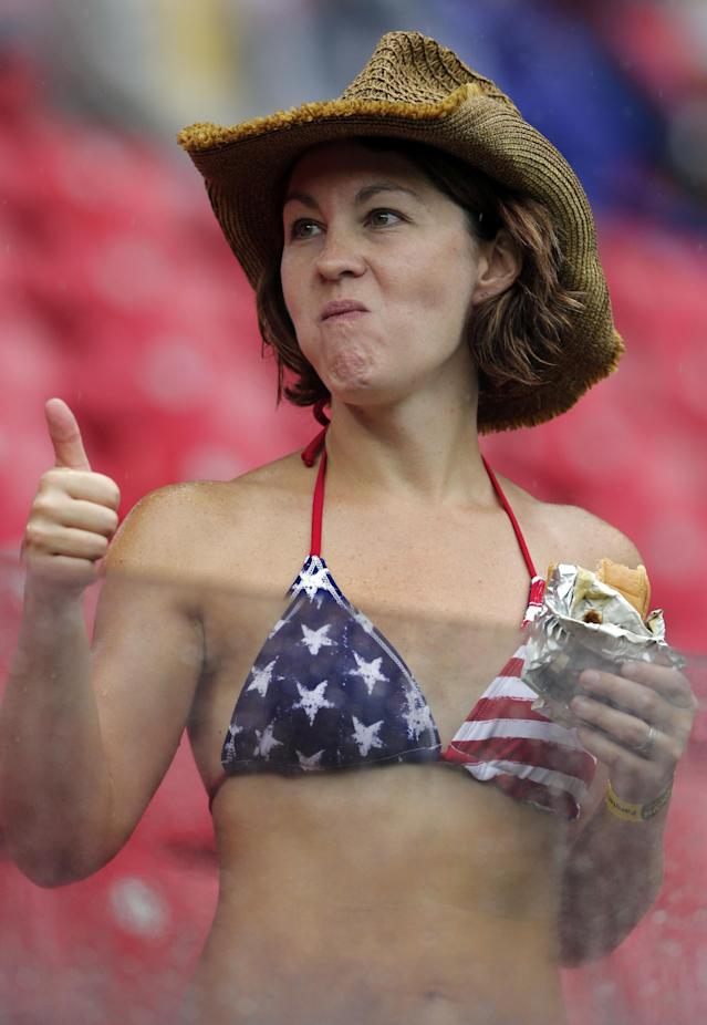 A US fan gives a thumbs up prior to the group G World Cup soccer match between the USA and Germany at the Arena Pernambuco in Recife, Brazil, Thursday, June 26, 2014. (AP Photo/Matthias Schrader)